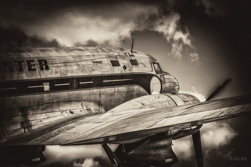 Old-fashioned Aircraft in the Sky Aluart