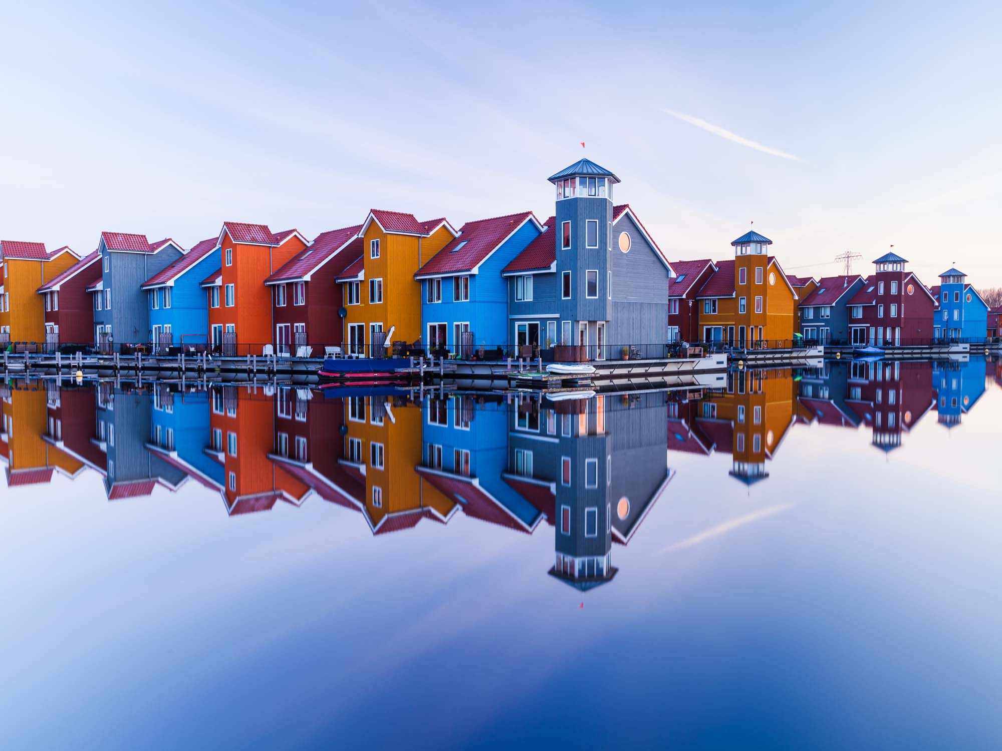 Glass printed Colored Houses Along the Water